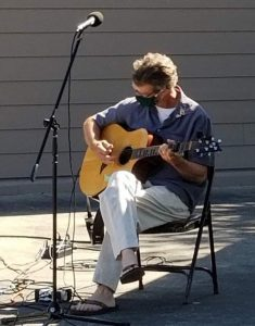 Michael Rivers plays at parking lot service on Sunday