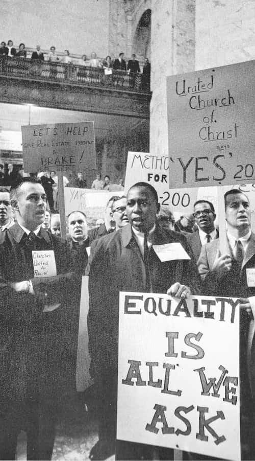 "Pastor Paul Beeman, left, singing ""We Shall Overcome"" inside the Capitol Rotunda, Olympia, Washington. From Life World Library: The United States, 1965."
